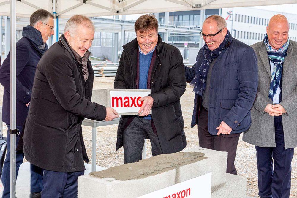 Maxon a posé la première pierre de ses bâtiments à Beynost